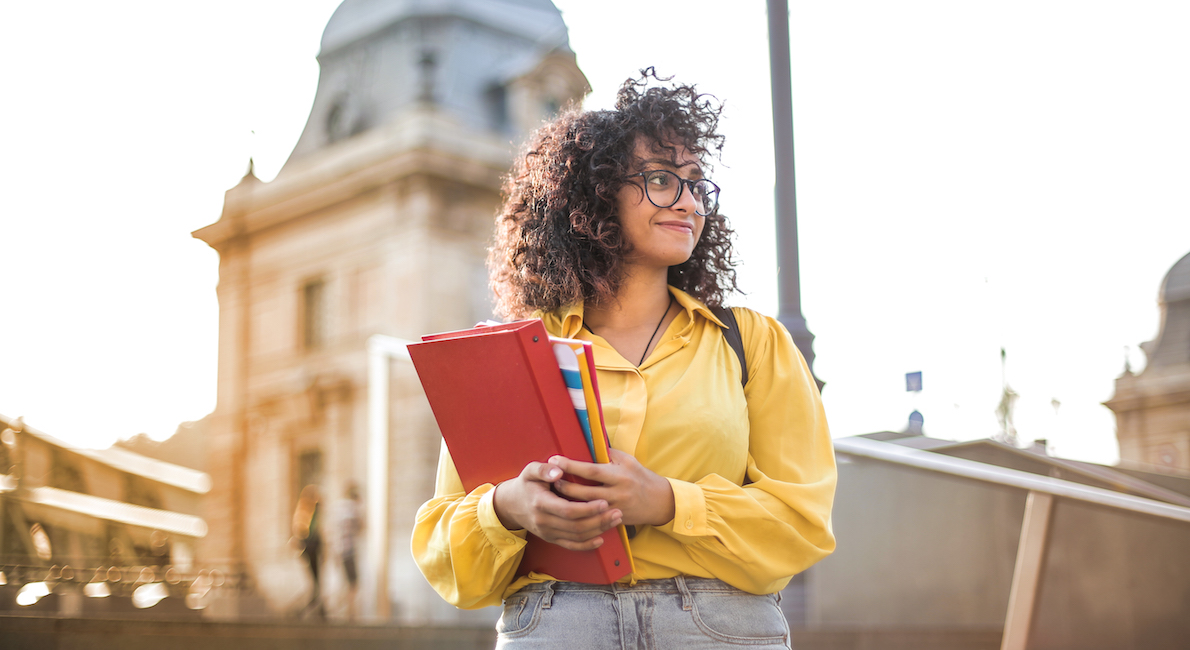 college student in yellow shirt at university